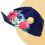 Casquette velo florale bleu et or Protea Flora - Vera Cycling